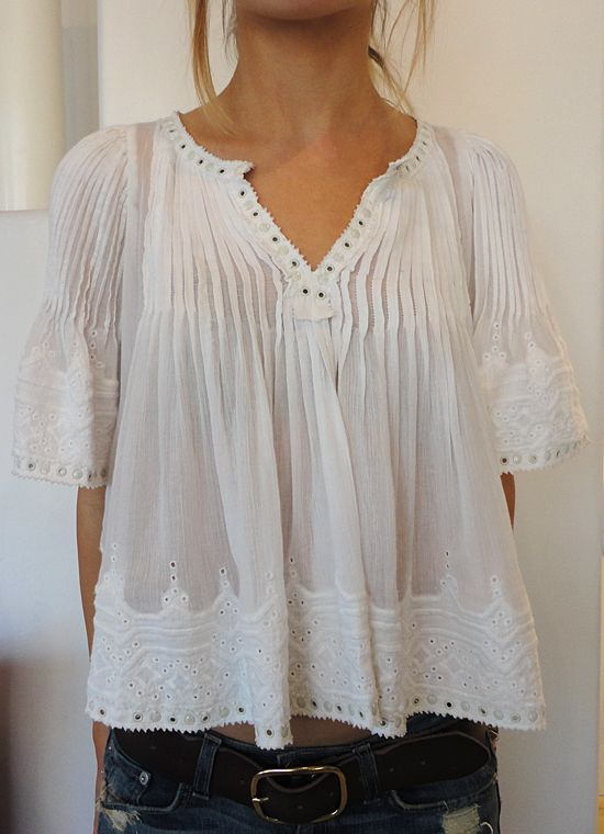 "Great top with a ""Victorian nightgown"" feel. The hem hits at the perfect spot with these jeans and you can let some skin peek out or wear a tucked in cami underneath"