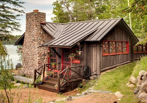 Front porch is cute. Red trim with log cabin and brown tin roof. #LogHomeDecor
