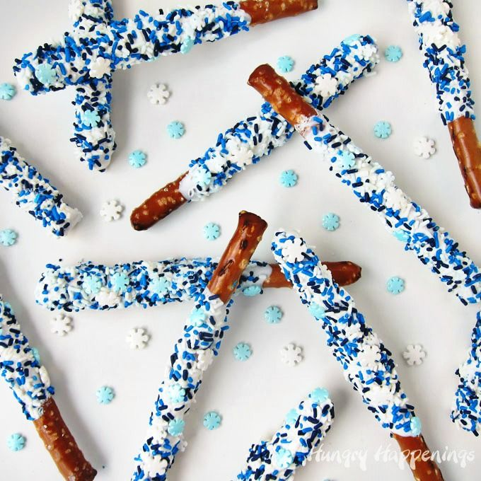 It's easy to make Snowflake Pretzel Pops for a Disney Frozen party or to give away as Christmas gifts or to snack on as a wintertime treat. See how they are made at HungryHappenings.com.