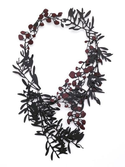 Necklace | Helen Shirk.  Mild steel, patina, china paint