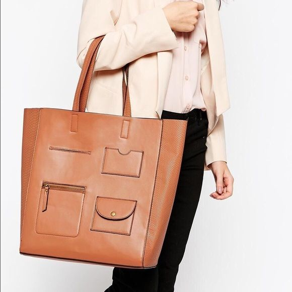 NWT/CART by New Look/ Utility Shopper Tote Bag NWT/CART by NEW LOOK/Utility Shopper Bag Offers irresistible fashion/straight off the runway styles/New Look is the British high street brands/I call the color a natural cognac ABOUT ME Coating: 100% Polyurethane, Lining: 100% Polyester, Inside Bag: 100% Polyester. LOOK AFTER ME Wipe Clean With A Damp Cloth Cart by New Look Smooth/leather-look fabric  Faux-snakeskin/panelling  Twin grab handles  Spacious Multiple pockets/front  100% Polyester…