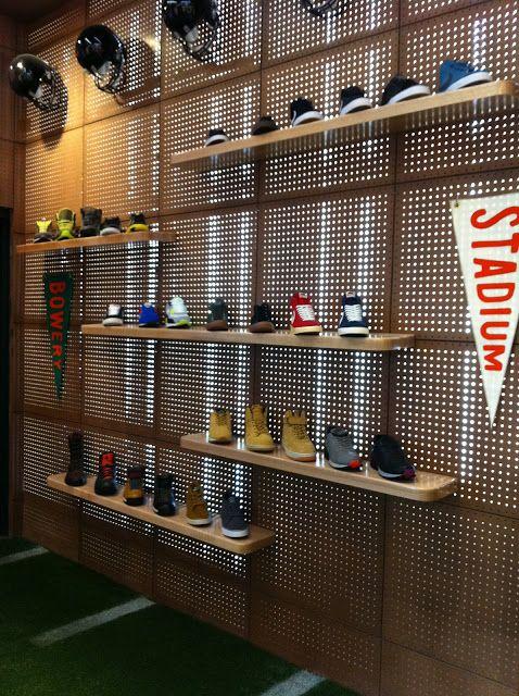 Pegboard shoe display at Nike stadium new york. #retail #merchandising #pegboard #display