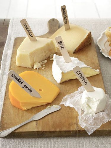 A genius idea: Use plain wooden or plastic stakes and a Sharpie to label a cheese board. #cheese