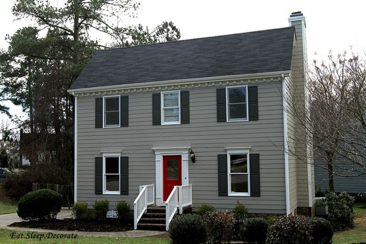 Exterior Paint Colors: Main Color- Sandy Hook by Benjamin Moore; Shutters & Side doors-Kendall Charcoal by Benjamin Moore; Front Door- Real Red by Sherwin Williams