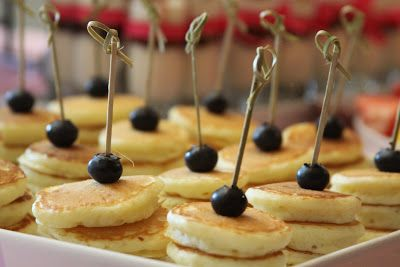 Mini pancakes with blueberries!  Perfect if served with syrup for dipping.  Grea…