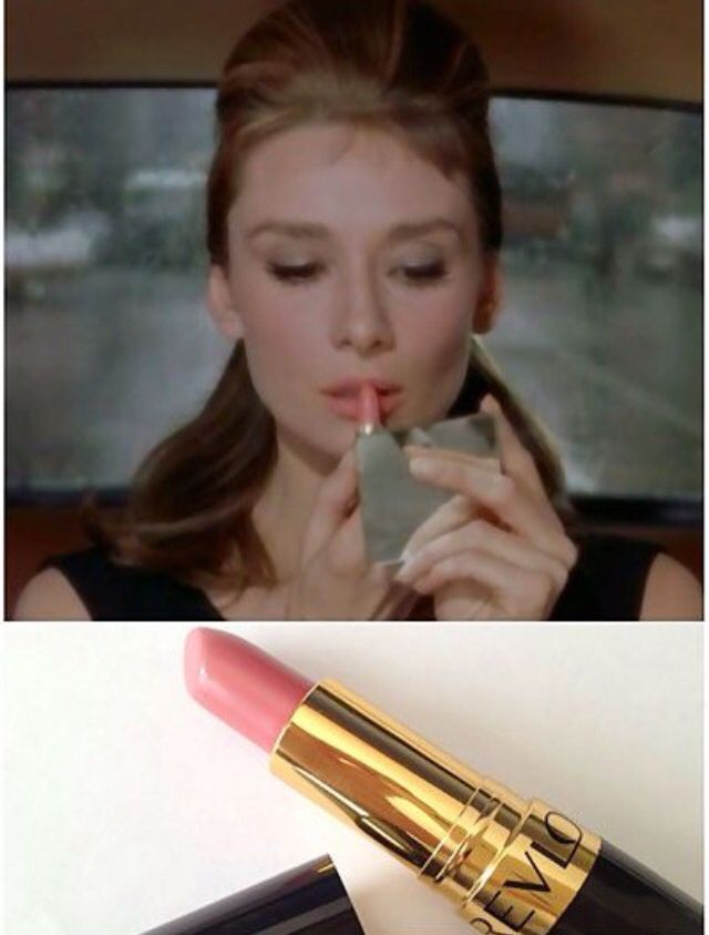 "Holly Golightly puts on her, Revlon Pink in the Afternoon lipstick in, ""Breakfast at Tiffany's."""