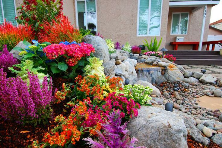drought tolerant gardening ideas | Waterfall surrounded by flowers