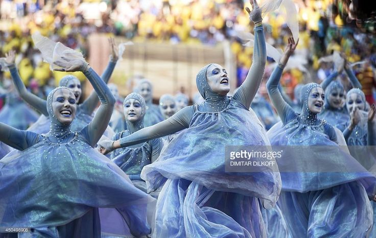 Performers take part in the opening ceremony of the 2014 FIFA World Cup at the Corinthians Arena in Sao Paulo on June 12, 2014.