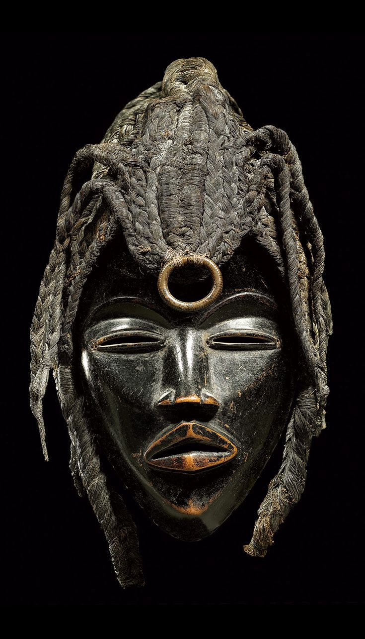 Africa | Mask from the Dan people of Ivory Coast or Liberia | Wood, fiber, metal | ca. prior to 1976