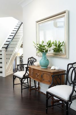 Entry...Mixing black and lighter colored woods