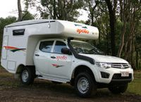 4WD Outback Camper  A new addition to the fleet is a four berth 4WD campervan. Suitable for 2 adults & 2 children. This vehicle has two anchorage points for child seats.  The Outback Camper is built on a twin cab 4WD chassis and includes two spacious double beds, and indoor cooking facilities. Other features include an outdoor shower, 75 litre fuel tank capacity and air-conditioned drivers cabin.