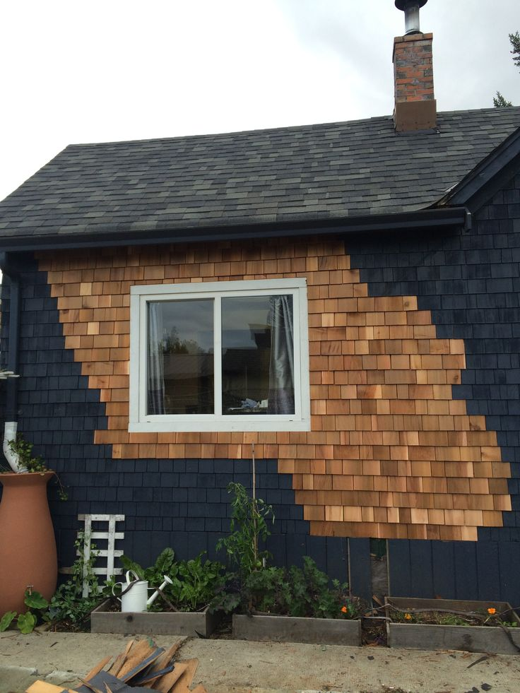 replacing singles on little blue house, getting ready to paint.