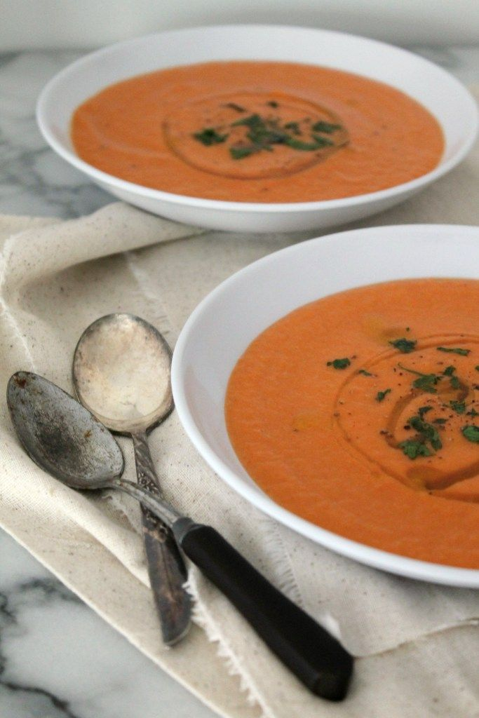 This ginger carrot soup is the ideal recipe to warm you up from the inside out! It's comfort food in a bowl! Vegan, gluten free, and healthy. Get the recipe from Cooking with Books