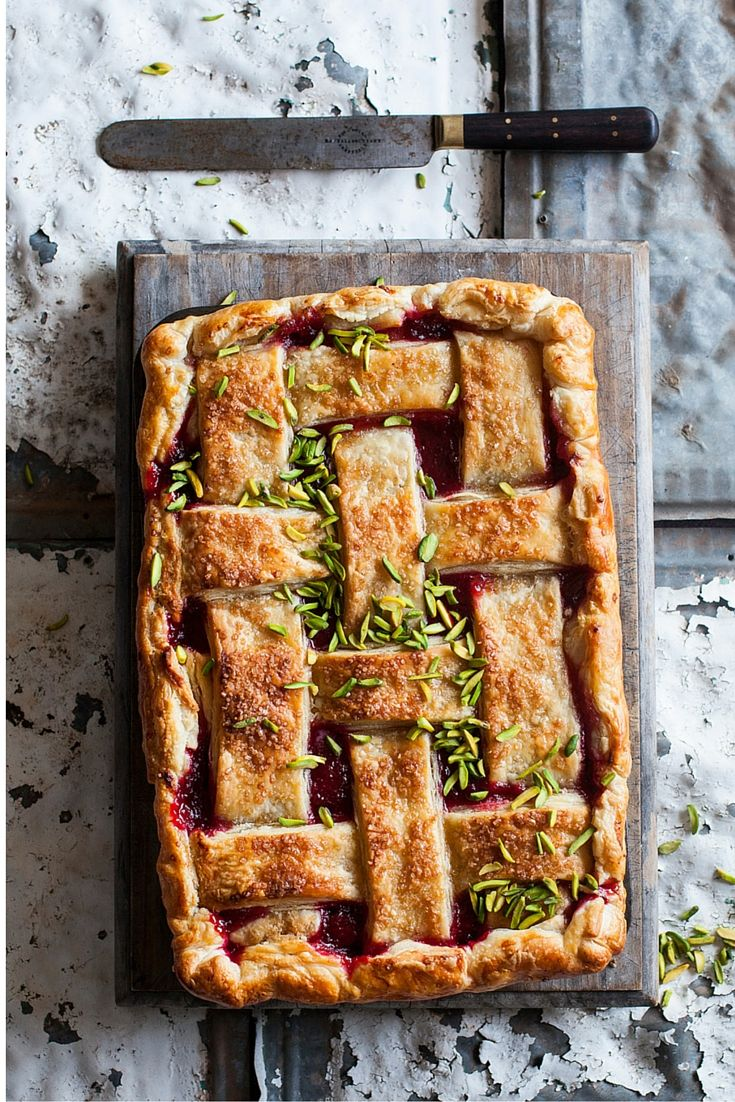 Rhubarb, orange and pistachio all wrapped in this lattice pie. Recipe by Phoebe Wood from her book, The Pie Project (Hardie Grant)