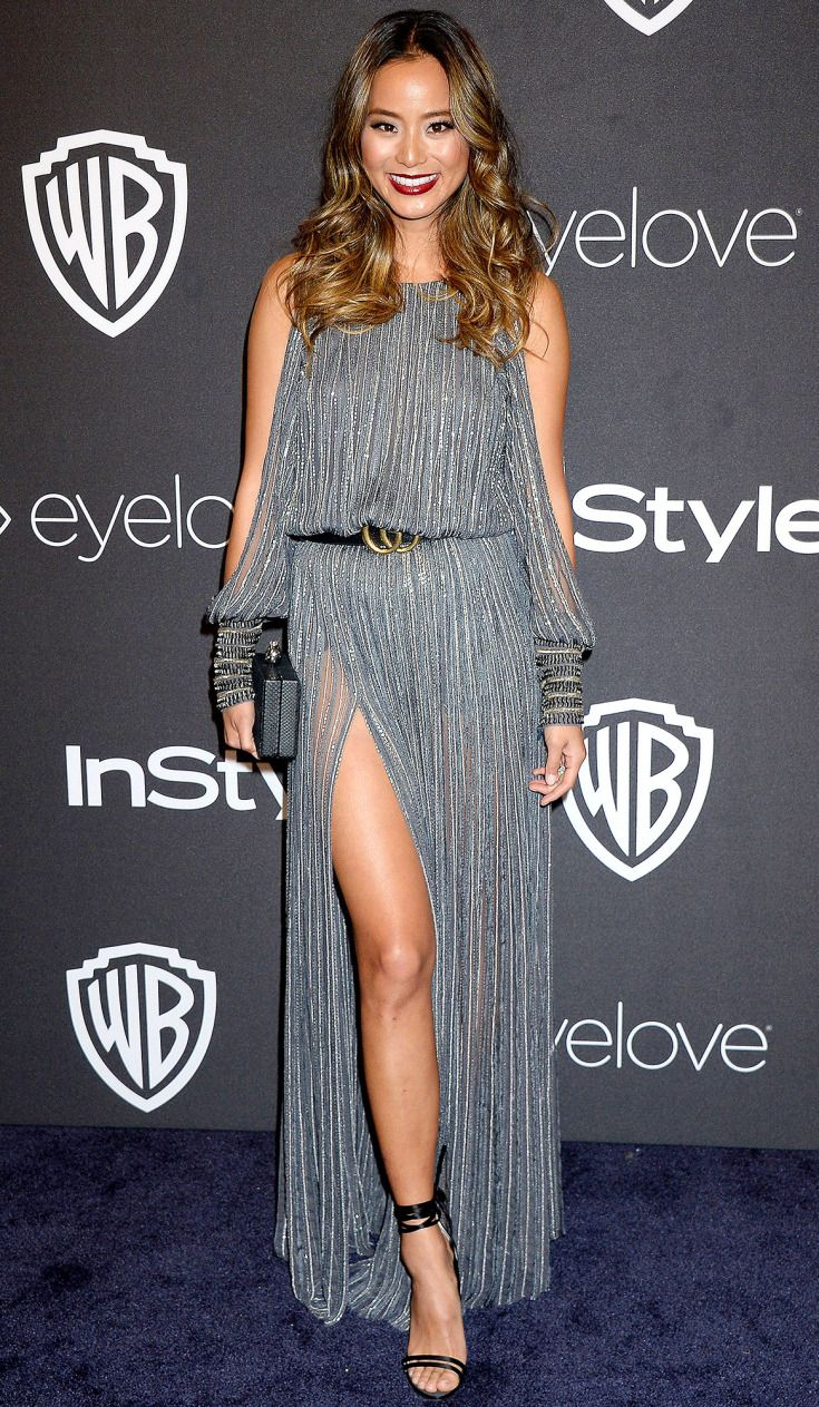 JAMIE CHUNG wears a sparkly slashed-sleeve Amanda Wakeley gown with a high slit, plus Jimmy Choo heels to the InStyle Party.