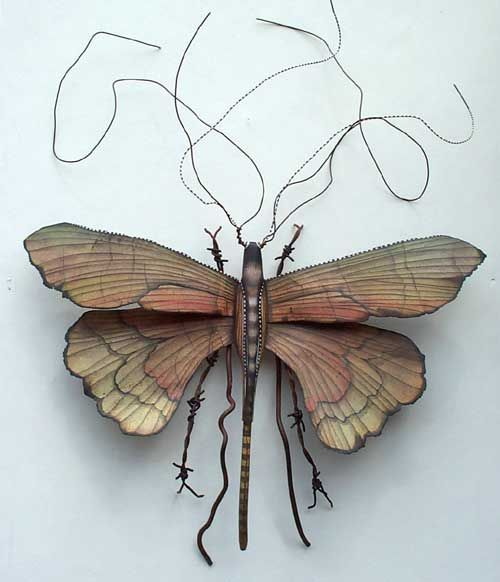 Kari von Wening - metal artist, (like the idea for a tattoo and placing personal and meaningful pictures on the wings)