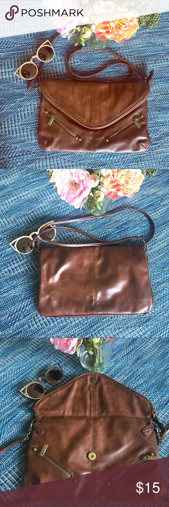 "Topshop Purse Brown/ Tan crossbody from Topshop. Can be worn across or over the shoulder. Two zippers on the front with pockets. Zipper pocket inside. Fold over zipper flap. Clean interior. Removable strap. 13""x 8.5"". 50"" strap. Topshop Bags Crossbody Bags"