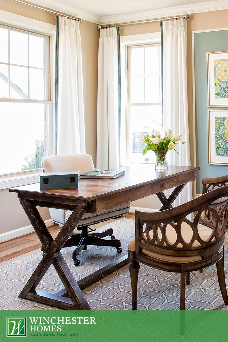 An Elegant Yet Rustic Wood Desk Paired With Moulded Wood Chairs Lend Warmth  And Structure To