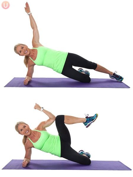 Chris Freytag demonstrating modified side plank crunch in a green tank top