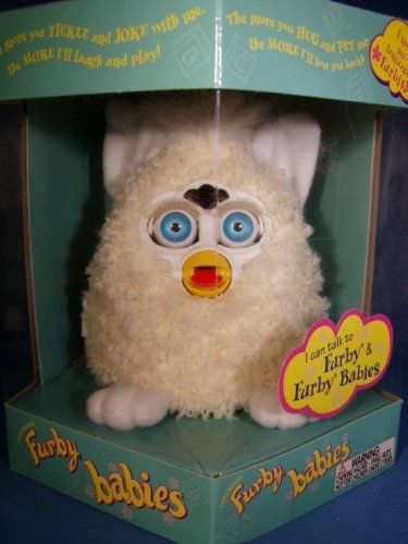 FURBY BABIES CREAM, WHITE FEET AND INNER EARS, CREAM HAIR by TIGER, HASBRO. $82.50. Electronic Furby baby. I can play games. I can say more than 800 phrases. Ready to love and eager to play. The more you play with me, the more I do!