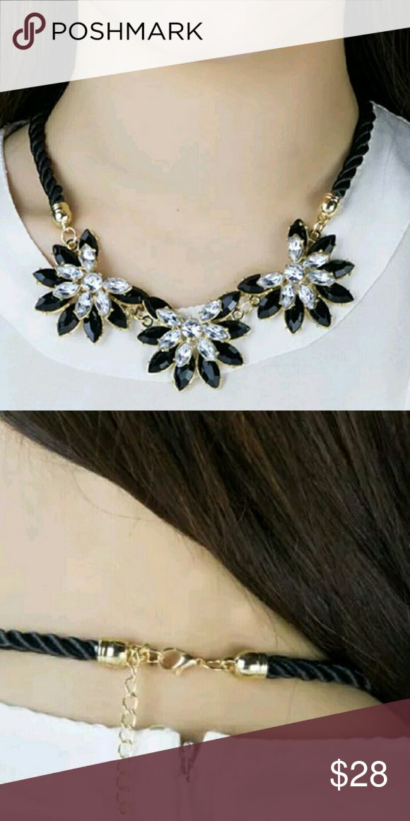 Statement necklace White topaz gems flower design chunky necklace statement.  Description: * Suitable for traveling. * Show your personality. * Gorgeous, shiny and fashionable. * A good decoration for fashion. * Wonderful gift for yourself and your lover. * A good ornaments for your daily lift or some important occasions.    Specifications: Main Material: Alloy Width: 4cm Total Length: 41.5cm-46.5cm Main Color: Black   Package includes: 1 x Woman Retro Three Crystal Sunflower Necklace…