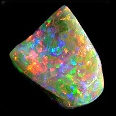 Solid Crystal Opal - Unset 2013 -  $30,000.00 -  One of a kind collectors opal from old olympic opal field in Coober Pedy - This huge chunk of opal could only be described as an amazing collectors item for those who can afford to spend the money. It is 100% dark red crystal opal right through. Stones like this unless a new opal field is found, will never be seen again.