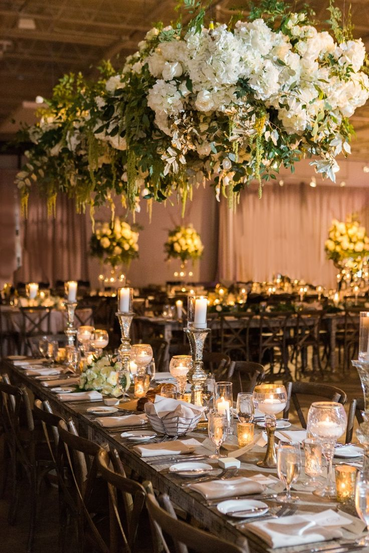 Rustic Table + Floral Chandelier with Greenery   Photo: Vue Photography.