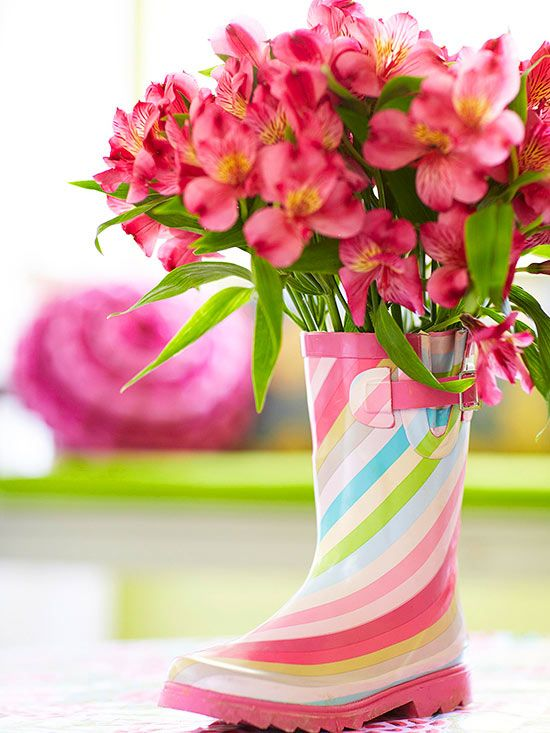 Put your best foot forward with a unique flower vase. Arrange your flowers in a regular vase (make sure it will fit inside the boot first). Then simply tuck the vase inside the boot -- the more colorful, the better!/