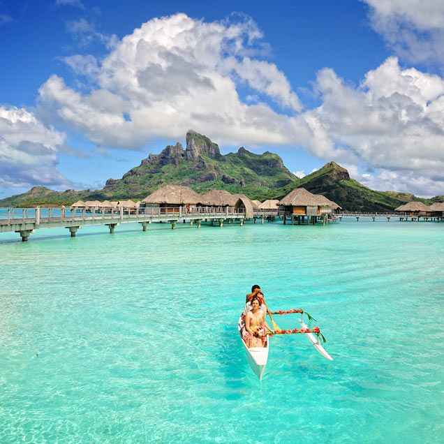 A Canoe Decorated With Hibiscus Ferried Four Seasons Resort Bora Couple Across