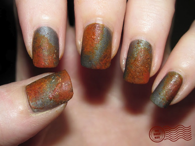 normally, I don't care about all these fingernail pictures.  sure, the colors are nice and the designs are skilled, but they are just fingernails.  these, however, I really like!  Rusted Nails. Just wonderful!
