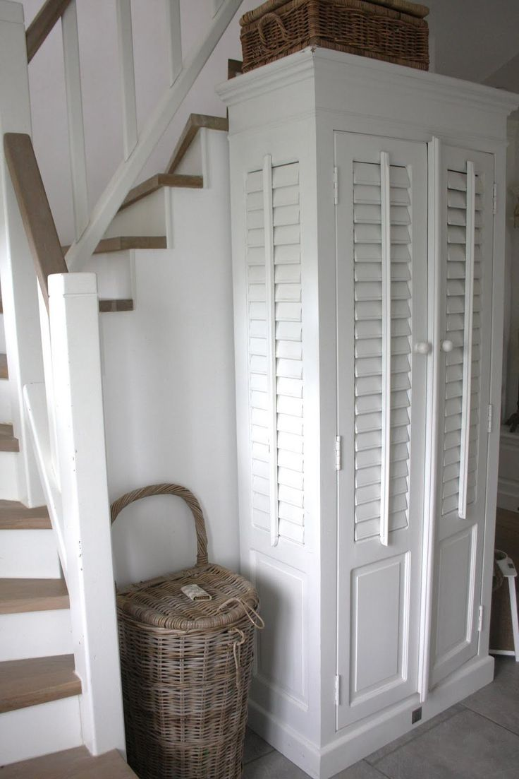 Hallway shutters and rattan  lovely combination