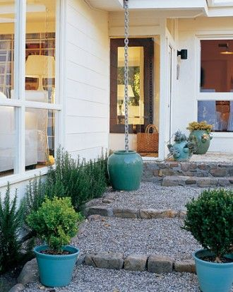 gravel walk, turquoise pots, water collection