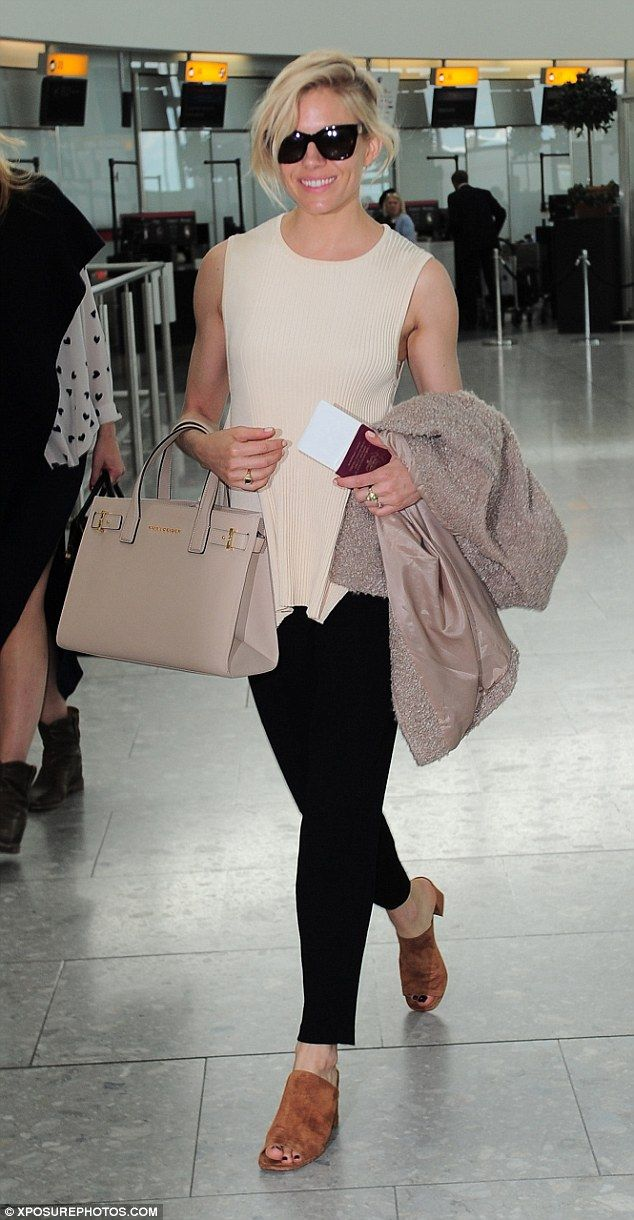 Next stop, Cannes! Sienna Miller was spotted flying out of Heathrow airport in London on T...