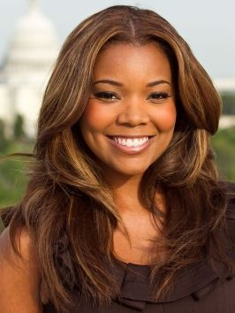 Gabrielle Union paired her long layered locks with a rich, warm brown hair color. The soft toffee highlights laced through the front layers add more dimension to the look.