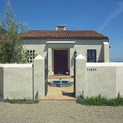 White Stucco Exterior And Walls. Fresh White Paint Covers Roughly Textured  Stucco U2014 A Hand