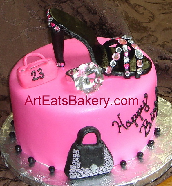 Pink fondant custom Diva birthday cake with black sugar shoe, handbags and faux diamond ring  Art Eats Bakery  Greenville, SC, 29607  www.arteatsbakery.com  Phone: 864-201-4448  Email: sales@arteats.com  See our Food network audition video www.youtube.com/ Cake Decorating