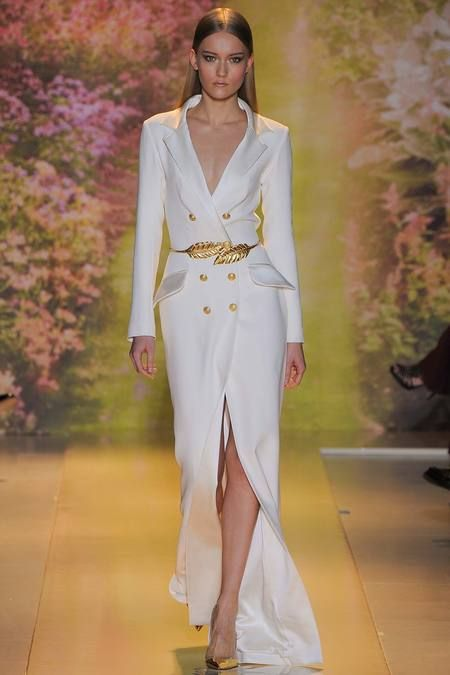 The ultimate evening coat dress by Zuhair Murad in sharpest white with old gold buttons and leaf belt. Skin mixes in as an accent piece and a collective gasp escapes as you enter to own the room.
