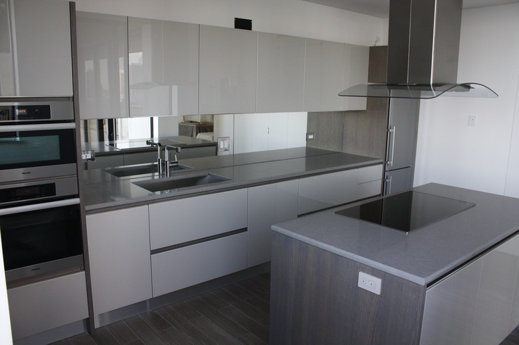 Modern Penthouse Kitchen, with solid wood and glass doors