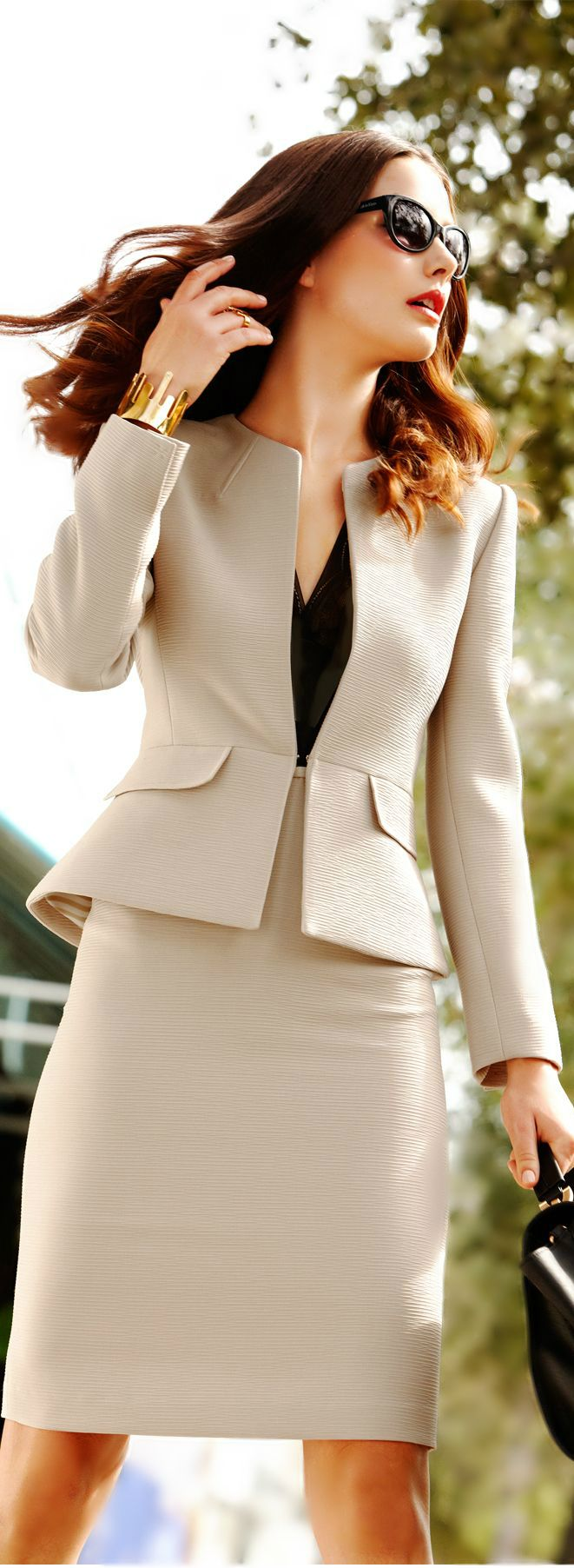 A neutral suit is a great asset to have in your wardrobe because it can be worn year round and goes with everything.  Getting just the right cut is essential to make it look sophisticated and chic instead of boring and frumpy.