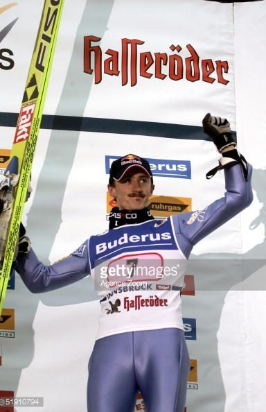 Adam Malysz of Poland gestures after placing second in the FIS World Cup In SkiJumping January 3 2005 in Innsbruck Austria Janne Ahonnen of Finland...