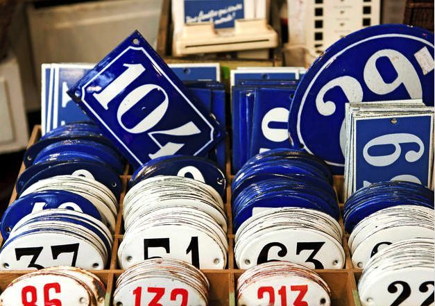 Next time you are in Paris, you can find a wide selection of vintage enamel house numbers at Au Petite Bonheur La Chance, located in the labyrinth of secondhand stores and antique shops in the Village Saint-Paul section of the Marais. Image via How to Spend It.