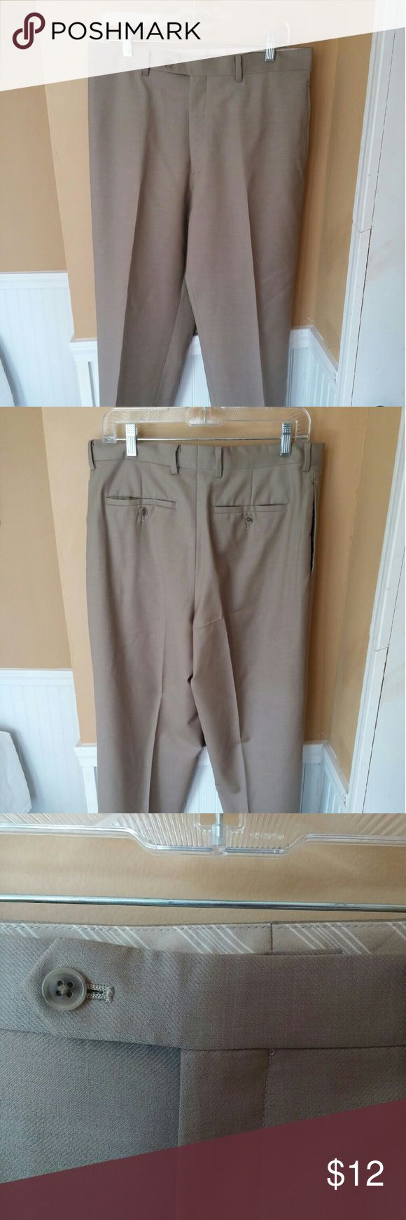 Calvin Klein Mens Pants Size 34x31 Wool Tan Great condition, non smoking household.  100% wool, lightweight fabric with a texture.  Actual measurements 34x31 Calvin Klein Pants Dress