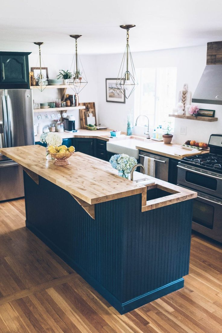 Jess Kirby's kitchen renovation features a new chalk painted island, brass pendant lights and butcher block counter tops