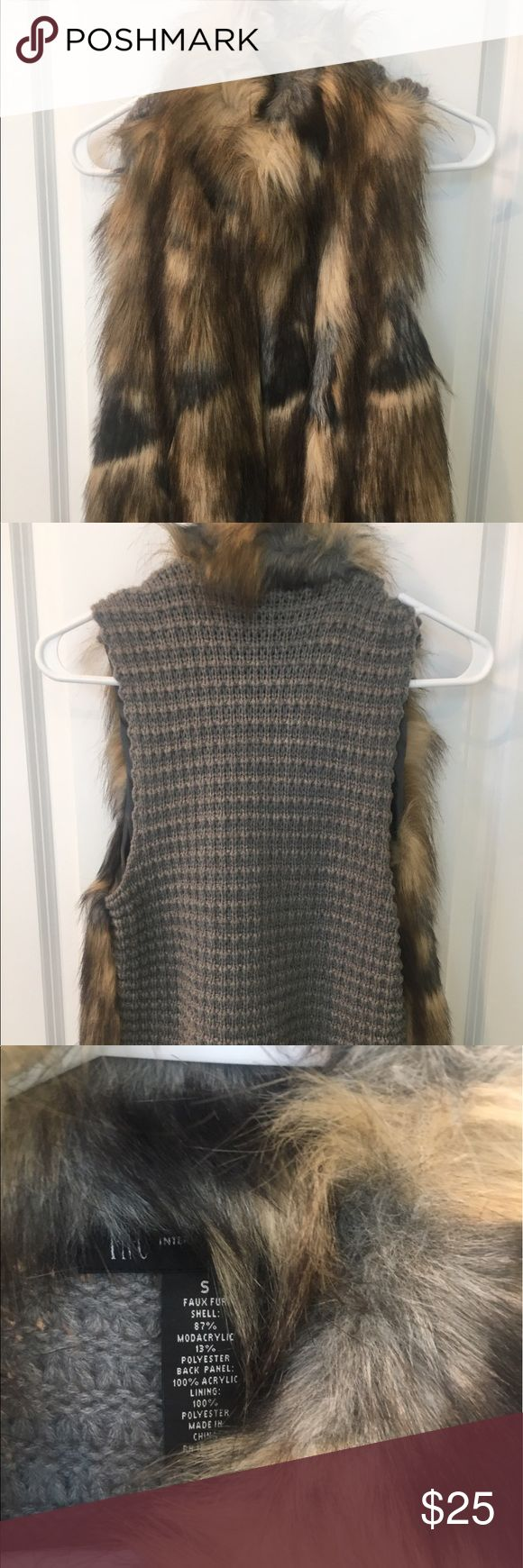 New INC faux fur vest New INC faux fur vest. No tags but never worn. It is beige and black with high neck and grey knit on the back. INC International Concepts Other