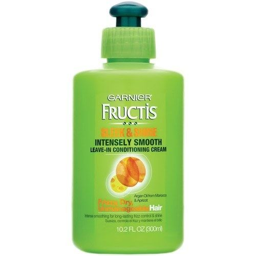 To tame curly and frizzy hair, try Garnier Fructis Sleek & Shine Intensely Smooth Leave-In Conditioner. | 21 Tips Everyone With Thick Hair Needs To Try