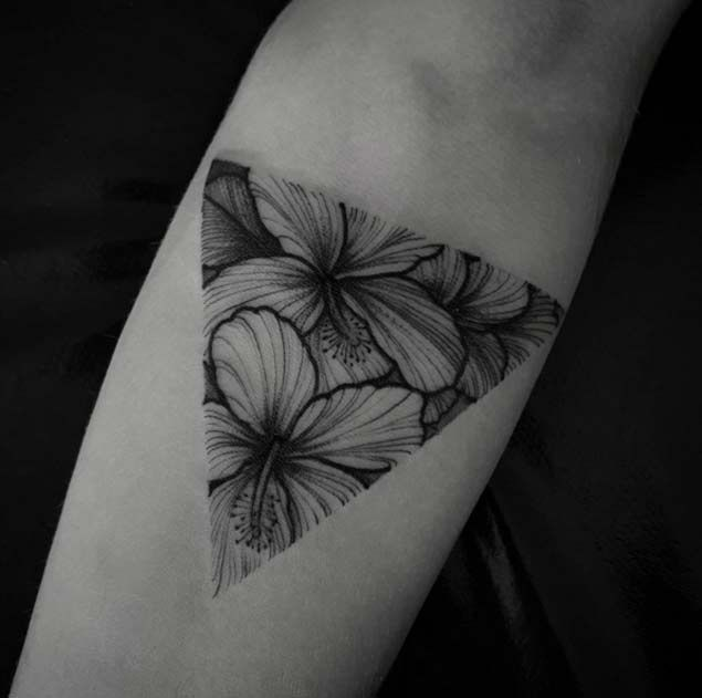 "Dotwork, blackwork, whatever label you wanna give this piece is fine with me, just don't forget to include ""Amazing."" Soft colorless flowers fit elegantly into a triangular glyph."