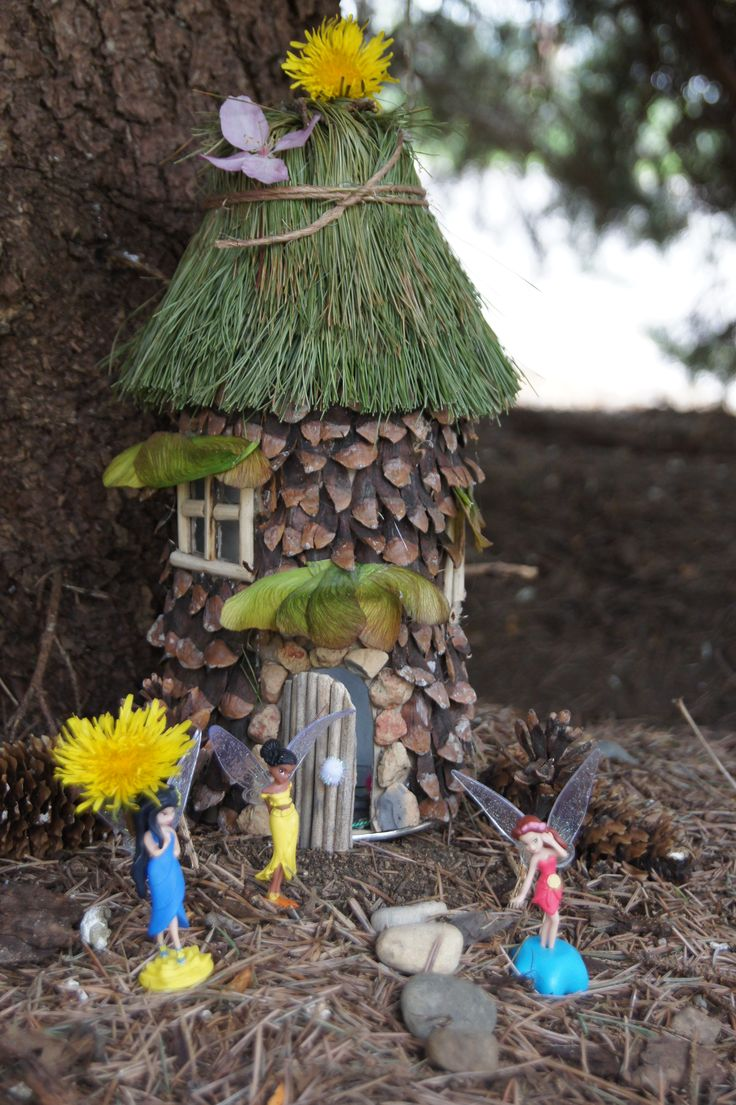 Our fairy house...made from a TJs coffee can, plastic cup, pine cones, rocks, pine needle clusters, maple seeds, and last years daylily flower stems...(Made 4/27/12 by my darling 5 year-old and me.)