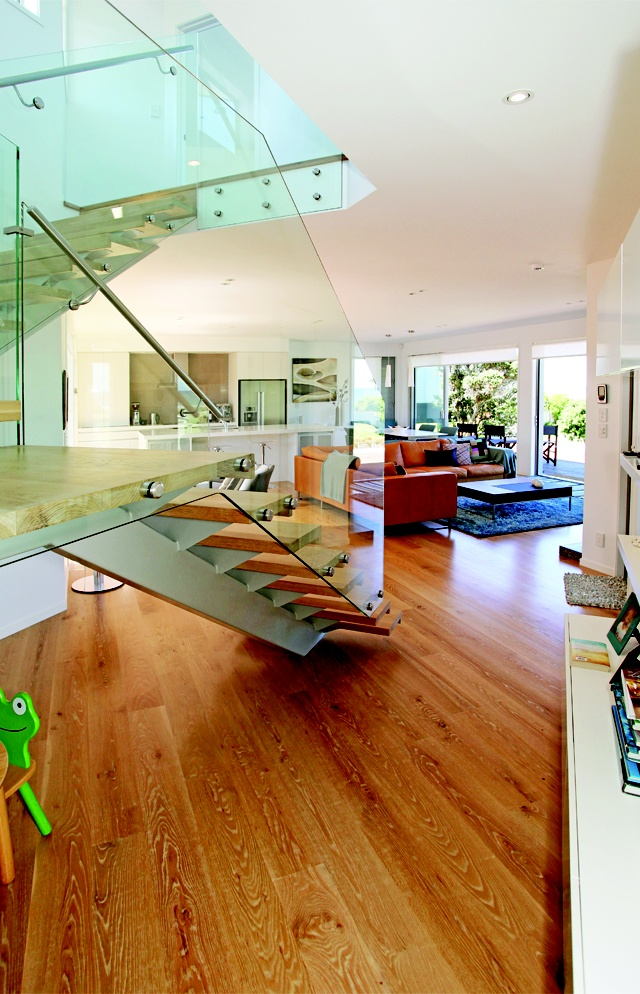 The architectural staircase is a striking central feature in the home.