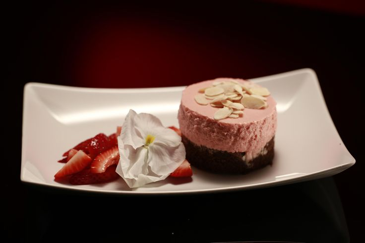 Raspberry Mousse Cake with Macerated Berries and Sugar Crusted Almonds