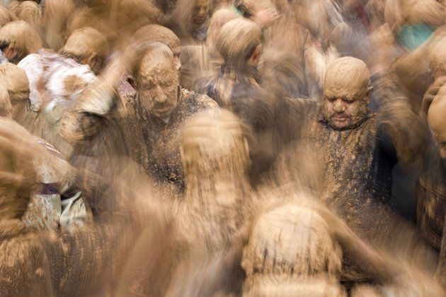 Ashura Mud Men   Iranian shi'a muslim men, in trance and covered in mud, mourning during the Day of Ashura, on which shi'a muslims commemorate the martyrdom of Husayn, grandson of Muhammad, and third shi'a imam. The mud is an important part of the local mourning ritual. Shot in the town of Bijar, Iran.  (Photo and caption by Guido Dingemans/ National Geographic Traveler Photo Contest)